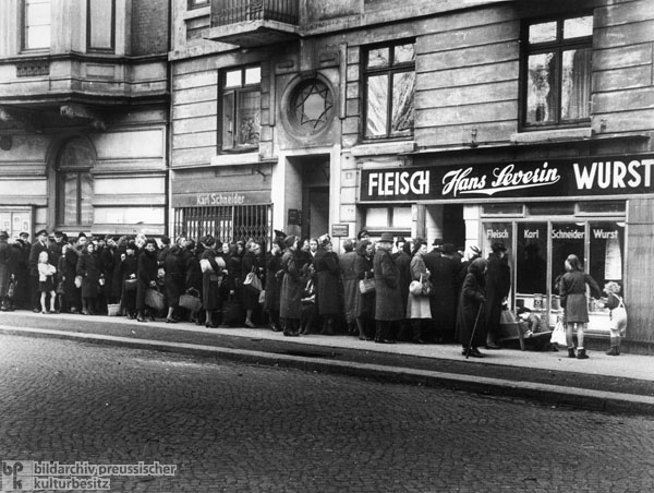 Waiting for Special Rations: Line in Front of a Butcher Shop in Hamburg-Winterhude (1947)