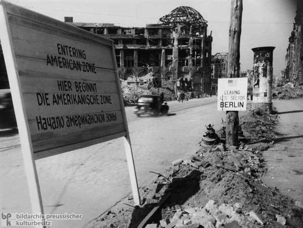 Sign Demarcating the Zonal Borders in Destroyed Berlin (1945)