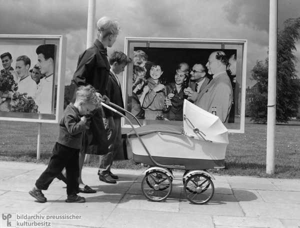 Mother with Children in Front of a Walter Ulbricht Poster, East Berlin (1964)