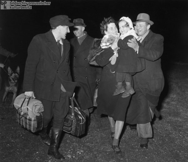 Family Members Are Greeted after a Successful Flight to the West (c. 1952)