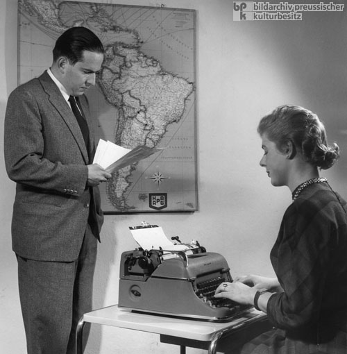 A Secretary Takes Dictation on a Typewriter (1954)