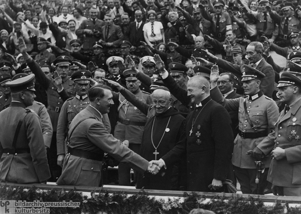 "Hitler Greets Reich Bishop Ludwig Müller and Abbott Albanus Schachleitner as Honorary Guests at the ""Reich Party Rally for Unity and Strength"" (September 4-10, 1934)"