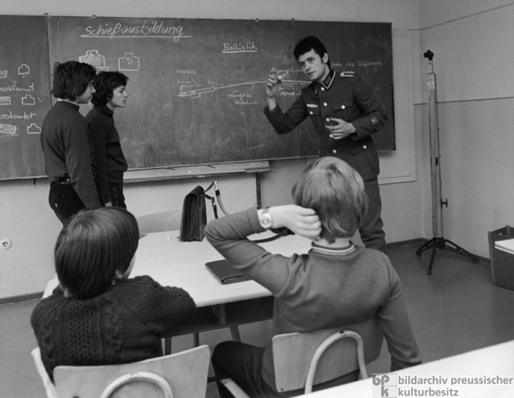 A Noncommissioned Officer in the National People's Army Gives Firearms Instruction in a GDR School (1975)