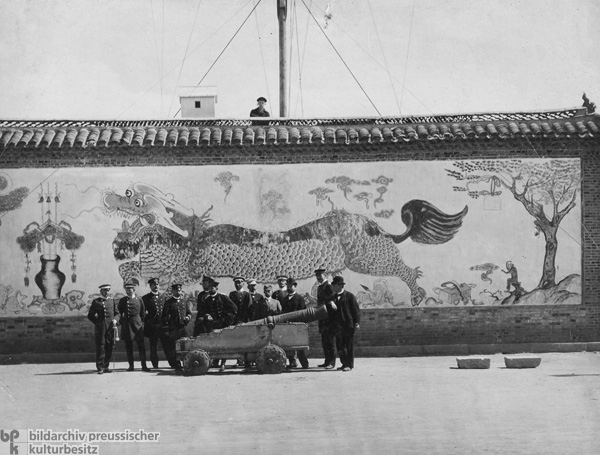German Naval Officers Pose Behind a Chinese Cannon in Kiaochow (November 1897)