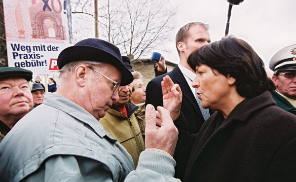 Ulla Schmidt, Federal Minister for Health and Social Affairs, Discusses Health Reform with Demonstrators (February 19, 2004)